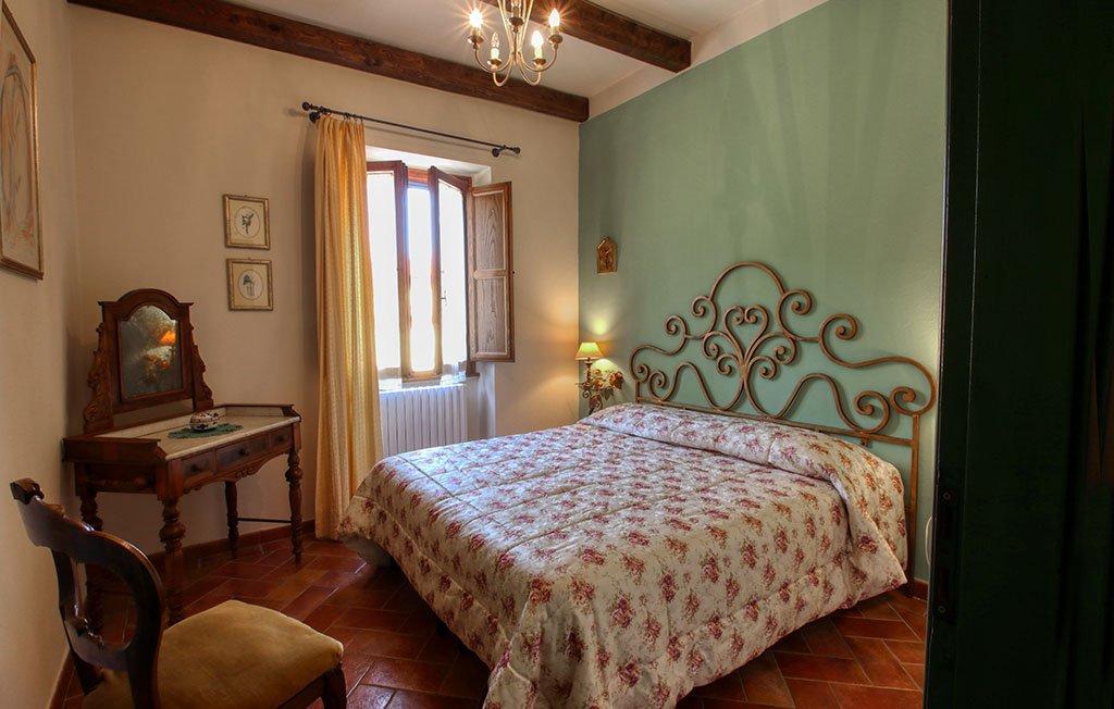 Appartamento il Girasole - Dettaglio della camera matrimoniale - Agriturismo Trebbiolo